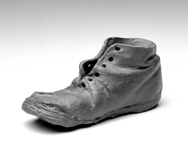 American. <em>Baby Shoe</em>, late 19th century. Metal, 2 1/2 x 2 x 6 in. (6.3 x 5.1 x 15.2 cm). Brooklyn Museum, Gift of Mrs. William E. S. Griswold in memory of her father, John Sloane, 41.980.40. Creative Commons-BY (Photo: Brooklyn Museum, 41.980.40_bw.jpg)