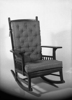 American. <em>Rocking Chair</em>, ca. 1881. Mahogany with upholstered pads for back and seat, 37 11/16 x 28 1/2 x 34 in. (95.8 x 72.4 x 86.3 cm). Brooklyn Museum, Gift of Mrs. William E. S. Griswold in memory of her father, John Sloane, 41.980.9. Creative Commons-BY (Photo: Brooklyn Museum, 41.980.9_acetate_bw.jpg)