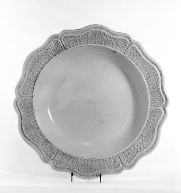 <em>Plate</em>. Glazed stoneware, 2 3/4 x 17 1/4 in. (7 x 43.8 cm). Brooklyn Museum, Gift of George W. Davison, 42.116. Creative Commons-BY (Photo: Brooklyn Museum, 42.116_view1_bw.jpg)