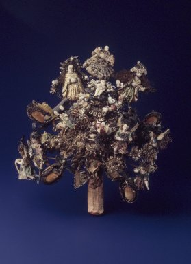 <em>Briscada Nativity Scene</em>, 18th or 19th century. Metal: Silver tinsel, cloth, pearls, leather, huamanga stone, pigment, wire, clay, glass, beads, foil, 9 x 7 1/2 x 3 1/2 in. Brooklyn Museum, Carll H. de Silver Fund, 42.15. Creative Commons-BY (Photo: Brooklyn Museum, 42.15.jpg)