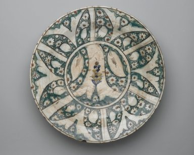 <em>Plate</em>, early 17th century. Ceramic, Kubachi ware; fritware, painted in black, blue and green with brown and yellow slips under a transparent glaze, 13 3/4 x 2 5/8 in. (35 x 6.6 cm). Brooklyn Museum, Gift of Mrs. Horace O. Havemeyer, 42.212.38. Creative Commons-BY (Photo: Brooklyn Museum, 42.212.38_top_PS2.jpg)