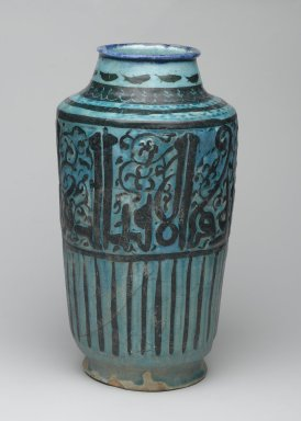 <em>Albarello</em>, 13th century. Ceramic; fritware, molded and painted in black and cobalt blue (rim) under a transparent turquoise glaze, 12 11/16 x 6 5/16 in. (32.3 x 16 cm). Brooklyn Museum, Gift of Mrs. Horace O. Havemeyer, 42.212.41. Creative Commons-BY (Photo: Brooklyn Museum, 42.212.41_PS2.jpg)
