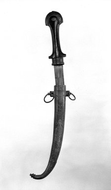 <em>Dagger with Scabbard</em>. Steel, 16 1/4 in. (41.3 cm). Brooklyn Museum, Gift of Percy C. Madeira, Jr., 42.245.15a-b. Creative Commons-BY (Photo: Brooklyn Museum, 42.245.15a-b_bw.jpg)
