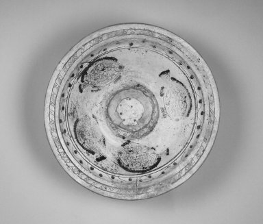 Coptic. <em>Large Dish Depicting Fish</em>, 6th century C.E. Clay, slip, 4 3/4 x 18 11/16 in. (12 x 47.5 cm). Brooklyn Museum, By exchange, 42.408. Creative Commons-BY (Photo: Brooklyn Museum, 42.408_interior.jpg)