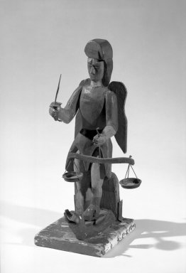 <em>Santo de Bulto, San Miguel</em>, late 19th century. Wood, pigment, 15 3/16 in.  (38.5 cm). Brooklyn Museum, Dick S. Ramsay Fund, 42.415. Creative Commons-BY (Photo: Brooklyn Museum, 42.415_bw.jpg)