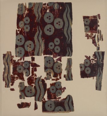 <em>Textile Fragments with Çintamani Pattern</em>, 16th-17th century. Dark red cut and voided twill velvet weave silk, brocaded with gold-colored silk and silver threads, 11 1/4 x 22 3/16 in. (28.6 x 56.4 cm). Brooklyn Museum, Gift of Elizabeth Riefstahl, 42.436.3. Creative Commons-BY (Photo: Brooklyn Museum, 42.436.3_PS2.jpg)