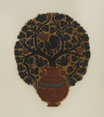 Coptic. <em>Vine Growing in Urn</em>, late 4th-early 5th century C.E. Linen, wool, 8 7/16 x 6 1/2 in. (21.5 x 16.5 cm). Brooklyn Museum, Gift of Pratt Institute, 42.438.1. Creative Commons-BY (Photo: Brooklyn Museum, 42.438.1_PS4.jpg)