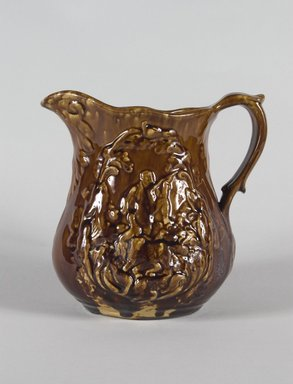 Charles Coxon. <em>Pitcher (Daniel Boone Design)</em>, 1850-1856. Rockingham-glazed earthenware, 7 5/16 in. (18.5 cm). Brooklyn Museum, Gift of Arthur W. Clement, 43.128.129. Creative Commons-BY (Photo: Brooklyn Museum, 43.128.129_PS5.jpg)