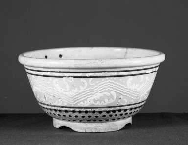 American. <em>Colander</em>. Glazed yellow-ware Brooklyn Museum, Gift of Arthur W. Clement, 43.128.139. Creative Commons-BY (Photo: Brooklyn Museum, 43.128.139_acetate_bw.jpg)