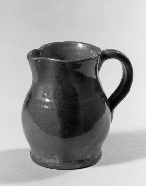 American. <em>Cream Pitcher</em>, 19th century. Red earthenware, 3 5/8 in. (9.2 cm). Brooklyn Museum, Gift of Arthur W. Clement, 43.128.191. Creative Commons-BY (Photo: Brooklyn Museum, 43.128.191_acetate_bw.jpg)
