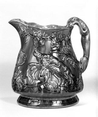 Edward Bennett. <em>Pitcher, Hound Handle</em>. Earthenware, Rockingham glaze, 1 5/8 in. (4.2 cm). Brooklyn Museum, Gift of Arthur W. Clement, 43.128.33. Creative Commons-BY (Photo: Brooklyn Museum, 43.128.33_bw.jpg)