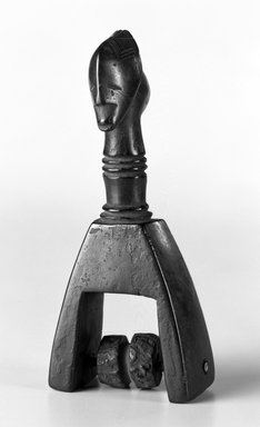 Guro. <em>Heddle Pulley</em>, early 20th century. Wood, applied surface, nut/seed/wood, surface coating, 5 7/8 x 2 9/16 in. (15.0 x 6.5 cm). Brooklyn Museum, Gift of Arthur Wiesenberger, 43.177.18. Creative Commons-BY (Photo: Brooklyn Museum, 43.177.18_bw.jpg)