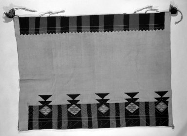 She-we-na (Zuni Pueblo). <em>Embroidered Dress</em>. Cotton, wool, 57 1/2 x 43 11/16in. (146 x 111cm). Brooklyn Museum, Anonymous gift in memory of Dr. Harlow Brooks, 43.201.193. Creative Commons-BY (Photo: Brooklyn Museum, 43.201.193_bw.jpg)