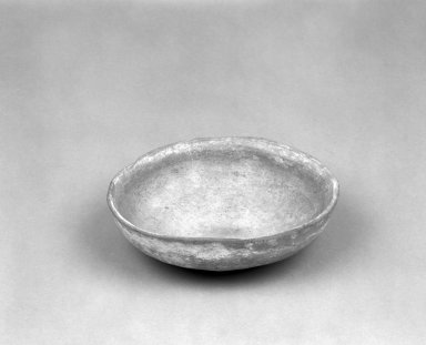 Native American. <em>Reddish buff Shallow Circular Bowl</em>. Clay, slip, 6 x 5 3/4 x 1 7/8 in.  (15.2 x 14.6 x 4.8 cm). Brooklyn Museum, Anonymous gift in memory of Dr. Harlow Brooks, 43.201.217. Creative Commons-BY (Photo: Brooklyn Museum, 43.201.217_bw.jpg)