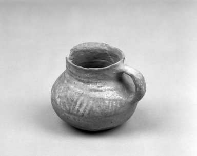 Southwest (unidentified). <em>Pitcher</em>. Clay, slip, 3 1/4 x 4 in.  (8.3 x 10.2 cm). Brooklyn Museum, Anonymous gift in memory of Dr. Harlow Brooks, 43.201.223. Creative Commons-BY (Photo: Brooklyn Museum, 43.201.223_bw.jpg)