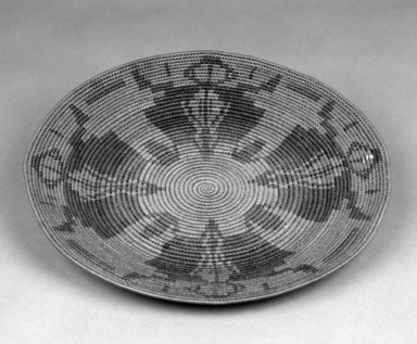 Native American (unidentified). <em>Finely Coiled Basketry Bowl or Plate with red patternes on interior</em>. Fiber, silk, 10 3/4 x 1 in.  (27.3 x 2.5 cm). Brooklyn Museum, Anonymous gift in memory of Dr. Harlow Brooks, 43.201.291. Creative Commons-BY (Photo: Brooklyn Museum, 43.201.291_bw.jpg)