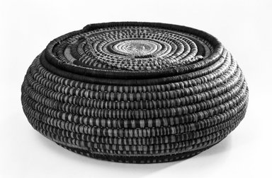 <em>Coiled Circular Basket and Cover</em>. Vegatable fiber, cord, dims. of A: (10.5 x 25.5 cm). Brooklyn Museum, Anonymous gift in memory of Dr. Harlow Brooks, 43.201.295a-b. Creative Commons-BY (Photo: Brooklyn Museum, 43.201.295a-b_bw.jpg)