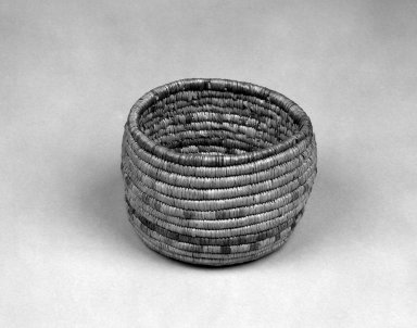 Native Alaskan. <em>Coiled Cylindrical Basket</em>, 20th century. plant material, 5 1/2 x 5 1/2 x 3 7/8 in. or (9.5 x 12.5 cm). Brooklyn Museum, Anonymous gift in memory of Dr. Harlow Brooks, 43.201.297. Creative Commons-BY (Photo: Brooklyn Museum, 43.201.297_bw.jpg)