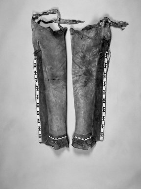 Apache. <em>Painted Leggings</em>. Hide, beads Brooklyn Museum, Anonymous gift in memory of Dr. Harlow Brooks, 43.201.3a-b. Creative Commons-BY (Photo: Brooklyn Museum, 43.201.3a-b_bw.jpg)