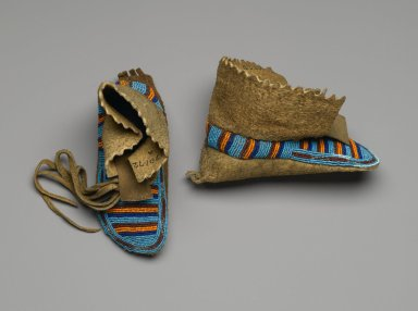 Interior Salish. <em>Pair of Child's Moccasins</em>, 1885-1895. Smoked hide, beads, cut steel beads, 7 1/2 x 3 1/8 in. (19.1 x 7.9 cm). Brooklyn Museum, Anonymous gift in memory of Dr. Harlow Brooks, 43.201.72a-b. Creative Commons-BY (Photo: Brooklyn Museum, 43.201.72a-b_PS2.jpg)