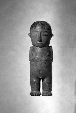 Nazca. <em>Standing Female Figure</em>, 600-1000. Ceramic, pigment, 14 3/16 x 3 9/16 in. (36 x 9 cm). Brooklyn Museum, Gift of Mr. and Mrs. William Flatow, Sr., 43.60. Creative Commons-BY (Photo: Brooklyn Museum, 43.60_bw.jpg)