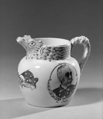 Cook Pottery Company. <em>Pitcher</em>, 1899. White earthenware, 4 x 4 5/8 x 2 5/8 in. (10.2 x 11.7 x 6.7 cm). Brooklyn Museum, Gift of Arthur W. Clement, 44.1.34. Creative Commons-BY (Photo: Brooklyn Museum, 44.1.34_acetate_bw.jpg)