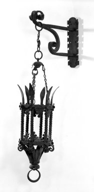 Spanish. <em>Lantern with Cage, Chain and Wall Bracket</em>, 15th century. Iron, H: 30 in. (76.2 cm). Brooklyn Museum, Gift of Mrs. Henry W. Healy, 44.138.7. Creative Commons-BY (Photo: Brooklyn Museum, 44.138.7_bw.jpg)