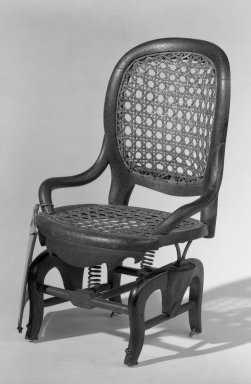 E. Hartwell. <em>Patent Model Rocking Chair</em>, 1869. Walnut, cane, 10 × 5 1/2 in. (25.4 × 14 cm). Brooklyn Museum, Gift of Mrs. Franklin Chace, 44.173.3. Creative Commons-BY (Photo: Brooklyn Museum, 44.173.3_acetate_bw.jpg)