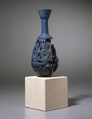 <em>Bottle with Openwork Shell</em>, ca. 1075-712 B.C.E. Egyptian blue, 6 11/16 x greatest diam. 2 15/16 in. (17 x 7.5 cm). Brooklyn Museum, Charles Edwin Wilbour Fund, 44.175. Creative Commons-BY (Photo: Brooklyn Museum, 44.175_SL1.jpg)