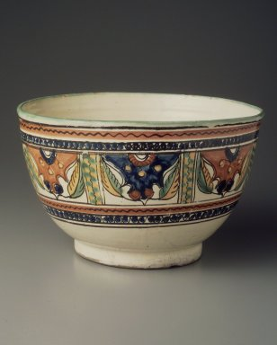 <em>Bowl</em>, 1850-1900. Earthenware, tin glaze, cobalt, antimony, copper, and iron in-glaze, 5 1/2 x 9 1/16 x 9 1/16 in. (14 x 23 x 23 cm). Brooklyn Museum, Museum Expedition 1944, Purchased with funds given by the Estate of Warren S.M. Mead, 44.195.54. Creative Commons-BY (Photo: Brooklyn Museum, 44.195.54.jpg)