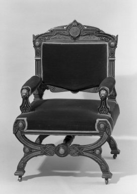 Possibly Solomon Fanning (American, 1790-1864). <em>Armchair (one of a pair with 44.24.3) Neo-Grec style</em>, ca. 1860-1862. Unidentified wood, walnut, metal, modern upholstery (reupholstered June 1989) Brooklyn Museum, Gift of Bertha Fanning Taylor, 44.24.2. Creative Commons-BY (Photo: Brooklyn Museum, 44.24.2_threequarter_view1_acetate_bw.jpg)
