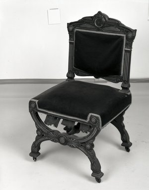 Possibly Solomon Fanning (American, 1790-1864). <em>Side chair (one of a set of four) Neo-Grec style</em>, ca. 1860-1862. Unidentified wood, walnut, metal, modern upholstery (reupholstered June 1989) Brooklyn Museum, Gift of Bertha Fanning Taylor, 44.24.6. Creative Commons-BY (Photo: Brooklyn Museum, 44.24.4_bw_IMLS.jpg)