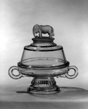 "Canton Glass Company (American, (1883-after 1999)). <em>Butter Dish with Lid, ""Jumbo"" pattern</em>, ca. 1882. Glass, 7 1/4 x 7 7/8 x 5 5/8 in. (18.4 x 20 x 14.3 cm). Brooklyn Museum, Gift of Mrs. Edwin P. Maynard, 44.32.8a-b. Creative Commons-BY (Photo: Brooklyn Museum, 44.32.8_bw.jpg)"
