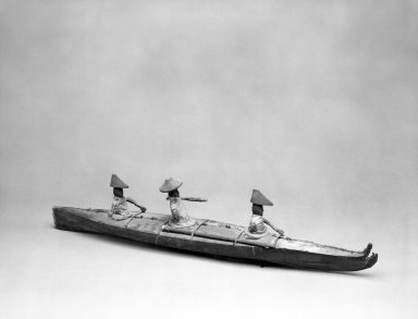 Aleut. <em>Model of Bidarka Boat with three seated figures</em>. Seal intestines?, wood, bone, fur, pigment, 26 1/4 x 6 x 4 in. or (6.8 x 10.0 x 15.0 cm). Brooklyn Museum, A. Augustus Healy Fund, 44.34.5. Creative Commons-BY (Photo: Brooklyn Museum, 44.34.5_bw.jpg)