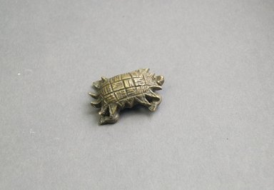 Akan. <em>Gold-weight (abrammuo): tortoise</em>, late 19th-mid 20th century. Copper, 3 1/8 x 1 3/8 x 1 9/16 in. (8 x 3.5 x 3.9 cm). Brooklyn Museum, Henry L. Batterman Fund, 44.4.5. Creative Commons-BY (Photo: Brooklyn Museum, 44.4.5_front_PS5.jpg)