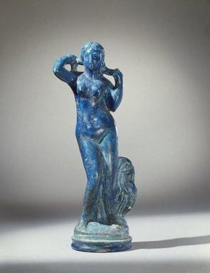 <em>Statuette of Aphrodite Anadyomene</em>, late 2nd century B.C.E. Faience, 14 3/16 x Diam. 4 1/4 in. (36 x 10.8 cm). Brooklyn Museum, Charles Edwin Wilbour Fund, 44.7. Creative Commons-BY (Photo: Brooklyn Museum, 44.7_SL3.jpg)