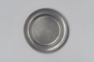 Spencer Stafford. <em>Plate</em>, ca. 1820-1830. Pewter, 5/8 x 8 x 8 in. (1.6 x 20.3 x 20.3 cm). Brooklyn Museum, Gift of Arthur W. Clement, 45.1.2. Creative Commons-BY (Photo: Brooklyn Museum, 45.1.2.jpg)