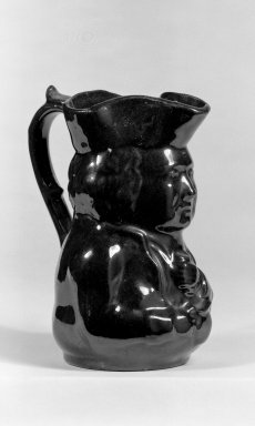 Possibly J. E. Jeffords & Co. Port Richmond Pottery. <em>Toby Pitcher</em>, 1868-1890. Yellow earthenware, 5 1/4 in. (13.3 cm). Brooklyn Museum, Gift of Arthur W. Clement, 45.1.34. Creative Commons-BY (Photo: Brooklyn Museum, 45.1.34_bw.jpg)