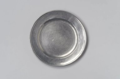 Jehiel Johnson. <em>Plate</em>, 1815-1825. Pewter, 5/8 x 7 15/16 x 7 15/16 in. (1.6 x 20.2 x 20.2 cm). Brooklyn Museum, Gift of Arthur W. Clement, 45.1.5. Creative Commons-BY (Photo: Brooklyn Museum, 45.1.5.jpg)