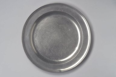 Joseph Danforth. <em>Dish</em>, 1780-1788. Pewter, 3/4 x 12 1/4 x 12 1/4 in. (1.9 x 31.1 x 31.1 cm). Brooklyn Museum, Designated Purchase Fund, 45.10.108. Creative Commons-BY (Photo: Brooklyn Museum, 45.10.108.jpg)