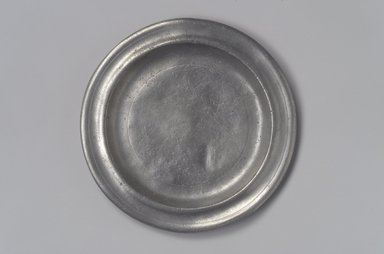 Thomas Danforth III (American, 1756-1840). <em>Plate</em>, 1777-1818. Pewter, 1/2 x 6 1/8 x 6 1/8 in. (1.3 x 15.6 x 15.6 cm). Brooklyn Museum, Designated Purchase Fund, 45.10.109. Creative Commons-BY (Photo: Brooklyn Museum, 45.10.109.jpg)