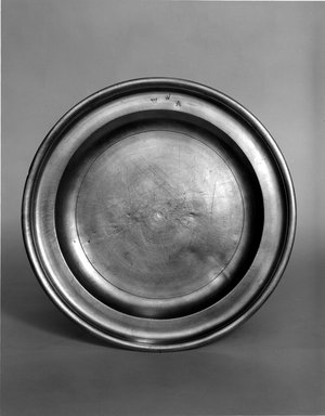 Nathaniel Austin. <em>Plate</em>, 1763-1807. Pewter, 5/8 x 8 3/4 x 8 3/4 in. (1.6 x 22.2 x 22.2 cm). Brooklyn Museum, Designated Purchase Fund, 45.10.11. Creative Commons-BY (Photo: Brooklyn Museum, 45.10.11_bw.jpg)