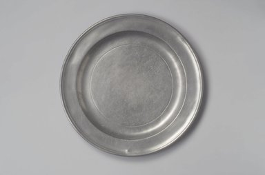 Henry Will. <em>Large Plate or Platter</em>, 1761-1793. Pewter, 1 x 13 1/8 x 13 1/8 in. (2.5 x 33.3 x 33.3 cm). Brooklyn Museum, Designated Purchase Fund, 45.10.169. Creative Commons-BY (Photo: Brooklyn Museum, 45.10.169.jpg)