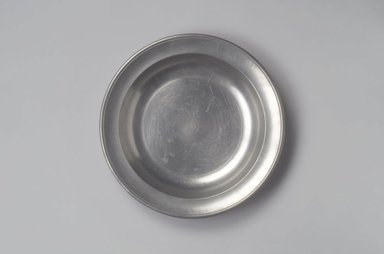 Thomas Danforth III (American, 1756-1840). <em>Dish</em>, ca. 1807-1813. Pewter, 1 5/8 x 11 5/8 x 11 5/8 in. (4.1 x 29.5 x 29.5 cm). Brooklyn Museum, Designated Purchase Fund, 45.10.182. Creative Commons-BY (Photo: Brooklyn Museum, 45.10.182.jpg)