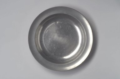 """<em>Dish, with Unidentified """"Love"""" Touch</em>, 18th century. Pewter, 1 5/8 x 13 x 13 in. (4.1 x 33 x 33 cm). Brooklyn Museum, Designated Purchase Fund, 45.10.222. Creative Commons-BY (Photo: Brooklyn Museum, 45.10.222.jpg)"""