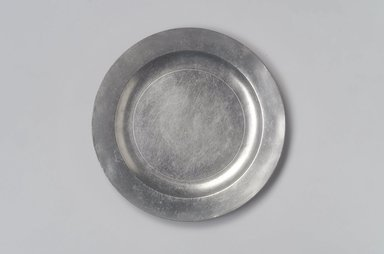Possibly Thomas Byles (1738-1771). <em>Plate</em>, 18th century. Pewter, 5/8 x 8 1/2 x 8 1/2 in. (1.6 x 21.6 x 21.6 cm). Brooklyn Museum, Designated Purchase Fund, 45.10.241. Creative Commons-BY (Photo: Brooklyn Museum, 45.10.241.jpg)