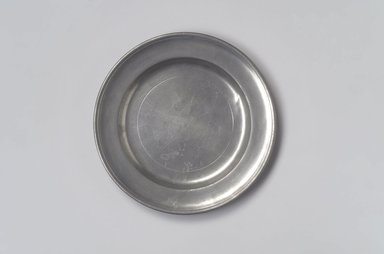 Samuel Pierce. <em>Plate</em>, 1792-1830. Pewter, 5/8 x 7 15/16 x 7 15/16 in. (1.6 x 20.2 x 20.2 cm). Brooklyn Museum, Designated Purchase Fund, 45.10.25. Creative Commons-BY (Photo: Brooklyn Museum, 45.10.25.jpg)