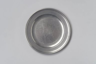 Joseph  Belcher Sr. or Joseph Belcher Jr.. <em>Plate</em>, 1769-1776 or 1776-1785. Pewter, 1/2 x 8 x 8 in. (1.3 x 20.3 x 20.3 cm). Brooklyn Museum, Designated Purchase Fund, 45.10.46. Creative Commons-BY (Photo: Brooklyn Museum, 45.10.46.jpg)