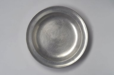 Jacob Whitmore. <em>Deep Dish</em>, 1758-1790. Pewter, 1 5/8 x 13 1/4 x 13 1/4 in. (4.1 x 33.7 x 33.7 cm). Brooklyn Museum, Designated Purchase Fund, 45.10.59. Creative Commons-BY (Photo: Brooklyn Museum, 45.10.59.jpg)