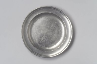Thomas Danforth II. <em>Plate</em>, 1755-1782. Pewter, 7/8 x 9 x 9 in. (2.2 x 22.9 x 22.9 cm). Brooklyn Museum, Designated Purchase Fund, 45.10.65. Creative Commons-BY (Photo: Brooklyn Museum, 45.10.65.jpg)